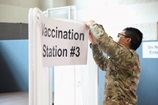 Service member puts vaccination station sign up
