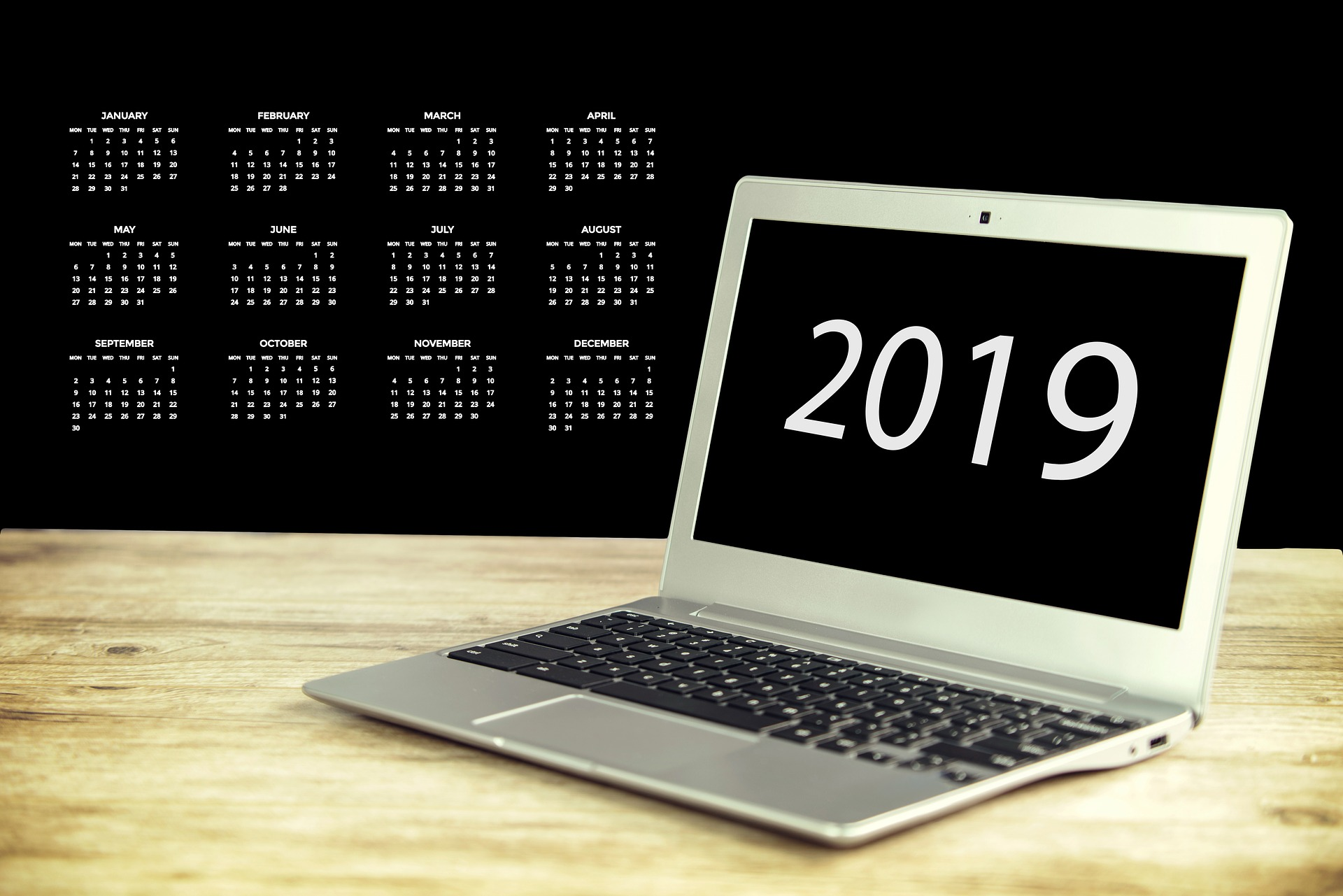 laptop with 2019 and months of the year in background
